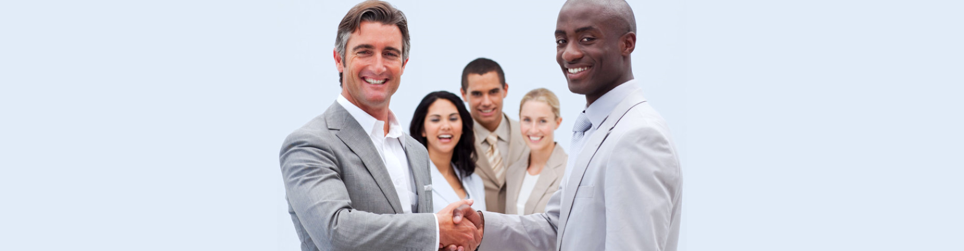 group of young professionals smiling